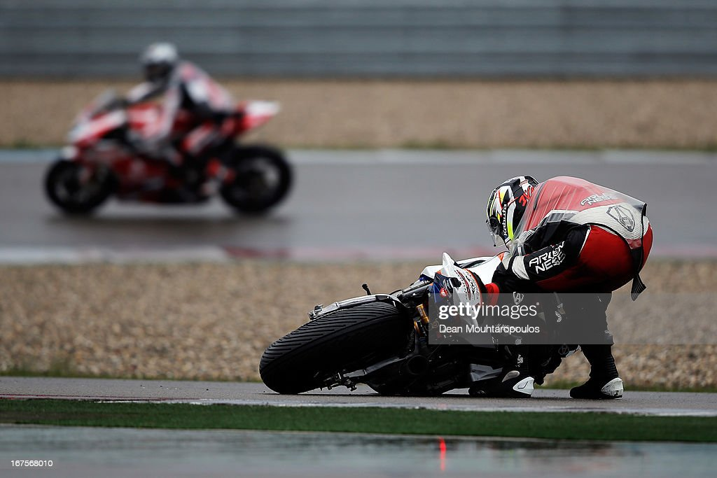 Ivan Clementi of Italy on the BMW S1000 RR for HTM Racing picks his bike off the track after a fall during the World Superbikes Practice Session at TT Circuit Assen on April 26, 2013 in Assen, Netherlands.