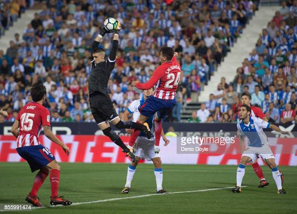 Ivan Cuellar of CD Leganes snatches the ball from Jose Maria Gimenez of Club Atletico de Madrid during the La Liga match between Leganes and Atletico...
