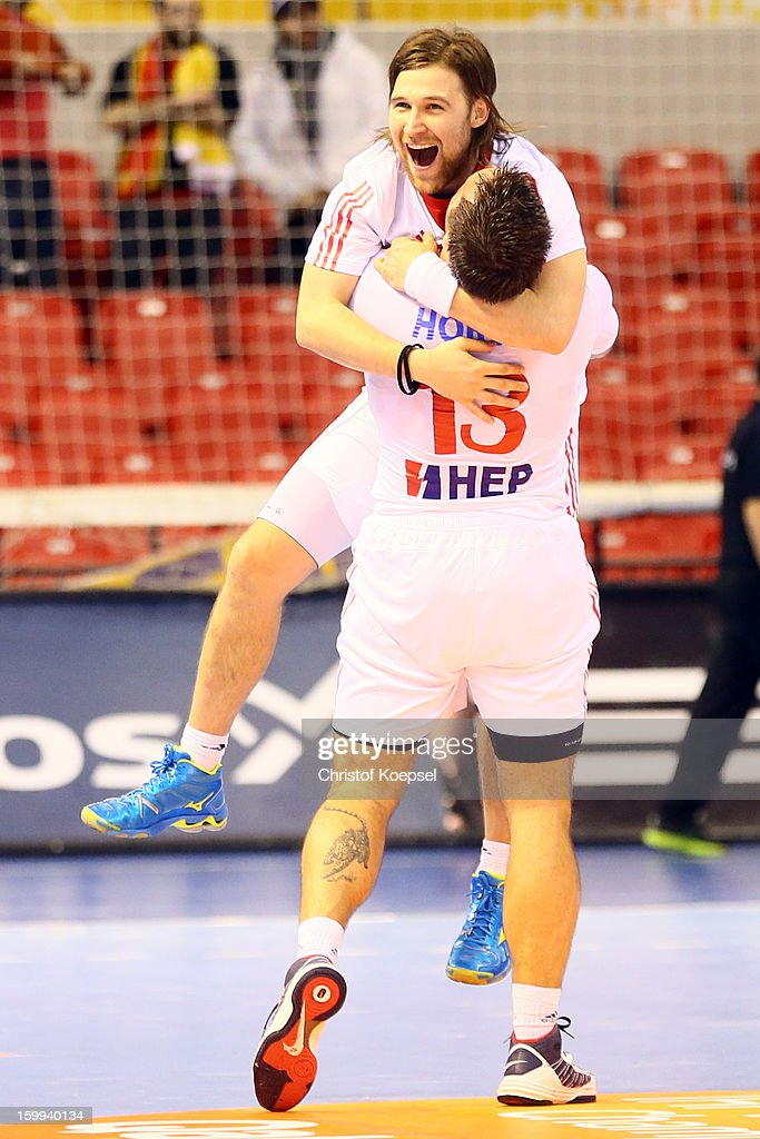 Ivan Cupic and Zlatko Horvat of Croatia celebrate the 30-22 victory after the quarterfinal match between France and Croatia at Pabellon Principe Felipe Arena on January 23, 2013 in Barcelona, Spain.