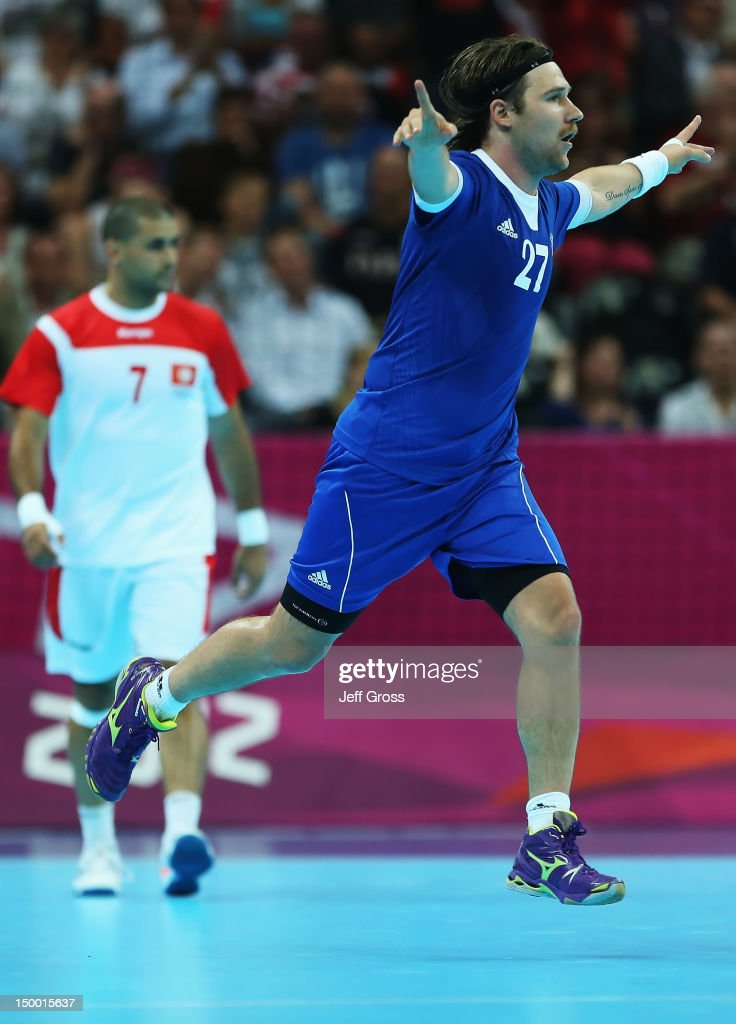 <a gi-track='captionPersonalityLinkClicked' href=/galleries/search?phrase=Ivan+Cupic&family=editorial&specificpeople=2294333 ng-click='$event.stopPropagation()'>Ivan Cupic</a> #27 of Croatia celebrates a goal against Tunisia during the Men's Quarterfinal match between Croatia and Tunisia on Day 12 of the London 2012 Olympic Games at The Basketball Arena on August 8, 2012 in London, England.