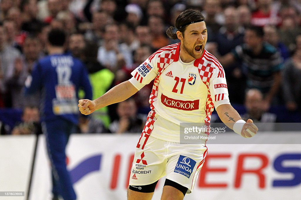 Ivan Cupic of Croatia celebrates a goal during the Men's European Handball Championship second semi final match between Serbia and Croatia at Beogradska Arena on January 27, 2012 in Belgrade, Serbia.