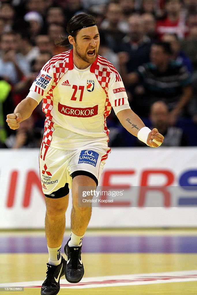 <a gi-track='captionPersonalityLinkClicked' href=/galleries/search?phrase=Ivan+Cupic&family=editorial&specificpeople=2294333 ng-click='$event.stopPropagation()'>Ivan Cupic</a> of Croatia celebrates a goal during the Men's European Handball Championship second semi final match between Serbia and Croatia at Beogradska Arena on January 27, 2012 in Belgrade, Serbia.