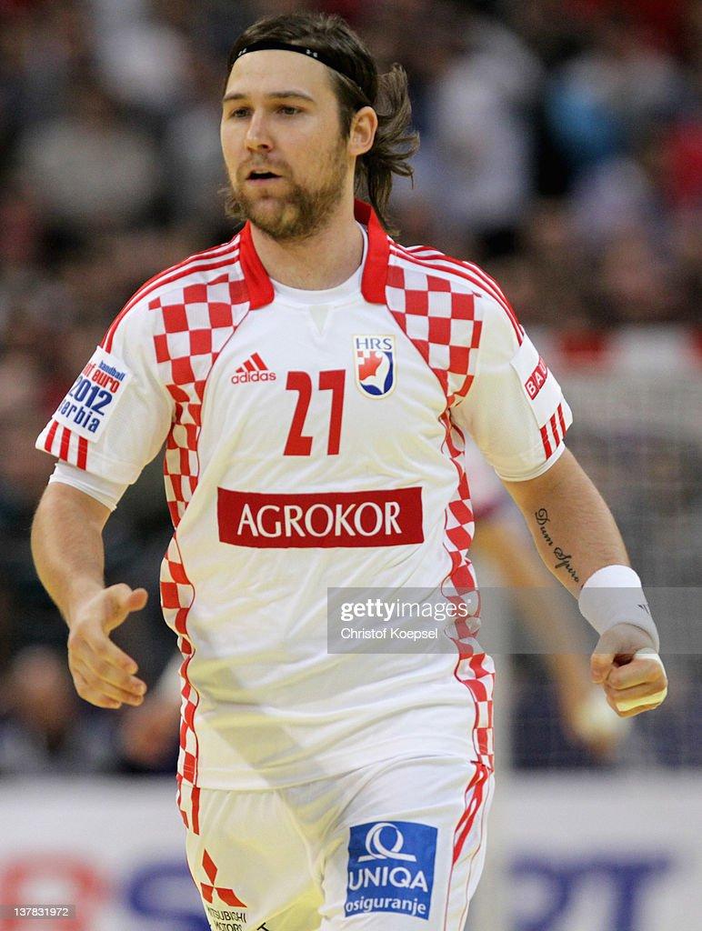 Ivan Cupic of Croatia celebrates a goal during the Men's European Handball Championship second semi final match between Serbia and Croatia at...