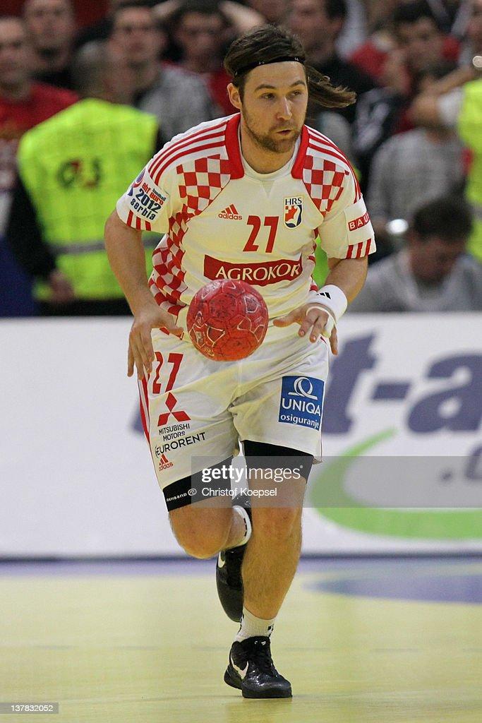 Ivan Cupic of Croatia leads the ball during the Men's European Handball Championship second semi final match between Serbia and Croatia at Beogradska...