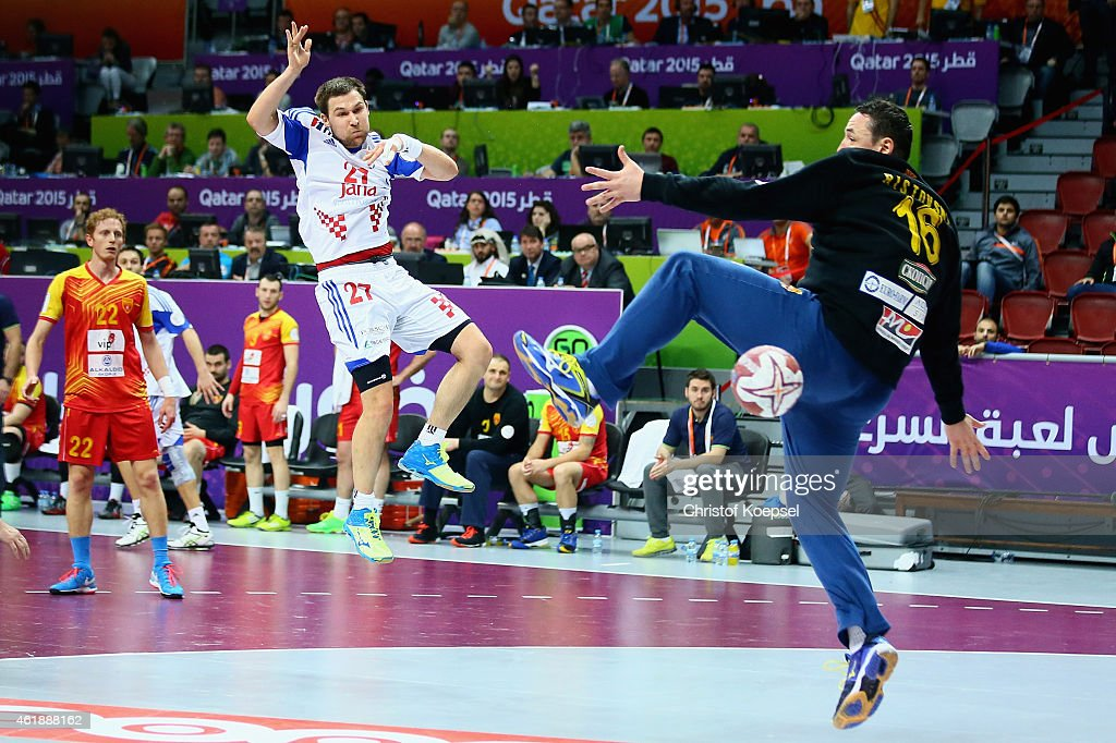Ivan Cupic of Croatia scores a goal against Borko Ristovski of Macedonia during the IHF Men's Handball World Championship group B match between Macedonia and Croatia at Duhail Handball Sports Hall on January 21, 2015 in Doha, Qatar.