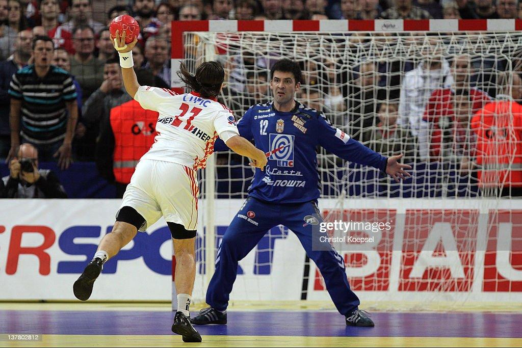 Ivan Cupic of Croatia scores a goal against Darko Stanic of Serbia during the Men's European Handball Championship second semi final match between...