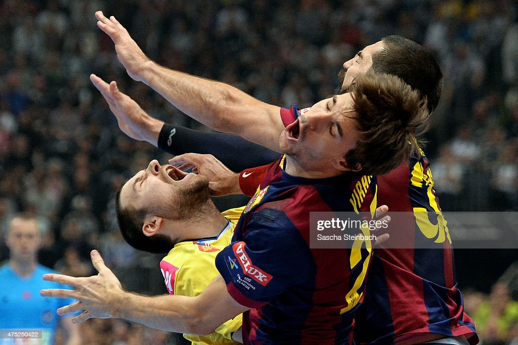 Ivan Cupic of Kielce is challenged by Viran Morros de Argila and Nikola Karabatic of Barcelona during the 'VELUX EHF FINAL4' semi final match FC Barcelona and KS Vive Tauron Kielce at Lanxess Arena on May 30, 2015 in Cologne, Germany.