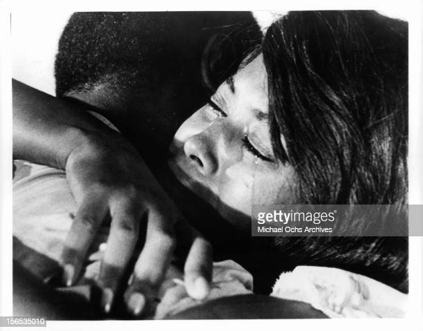 Ivan Dixon holds Abbey Lincoln in a scene from the film 'Nothing But A Man' 1964