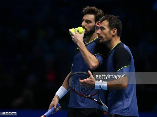 Ivan Dodig and Marcel Granollers against Jamie Murray and Bruno Soares during Day Four of the Nitto ATP World Tour Finals played at The O2 Arena...