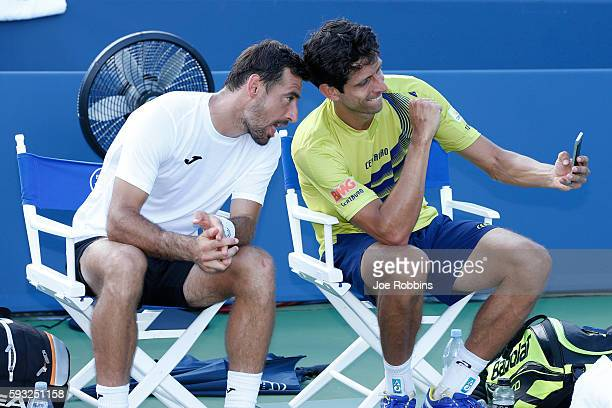 Ivan Dodig of Croatia and Marcelo Melo of Brazil take a selfie after defeating JeanJulien Rojer and Horia Tecau in the men's doubles final on Day 9...