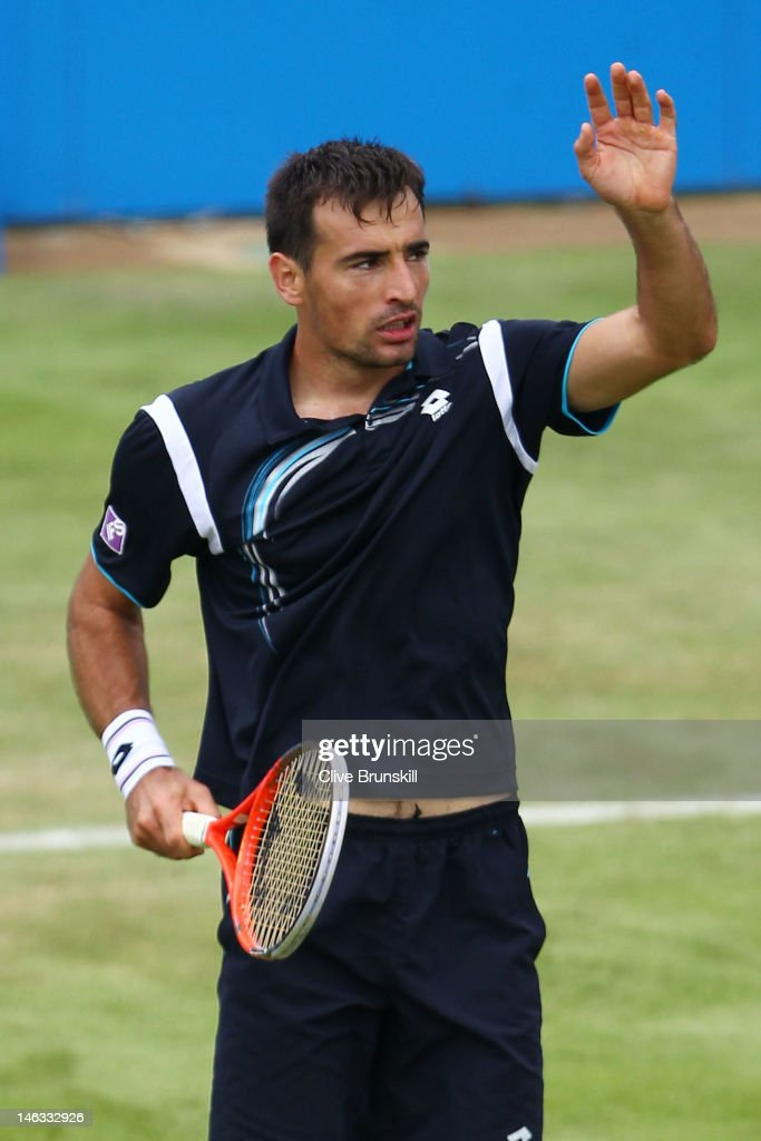 Ivan Dodig of Croatia celebrates winning his mens singles third round match against Jo-Wilfried Tsonga of France on day four of the AEGON Championships at Queens Club on June 14, 2012 in London, England.