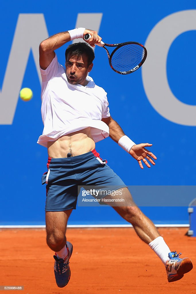 <a gi-track='captionPersonalityLinkClicked' href=/galleries/search?phrase=Ivan+Dodig&family=editorial&specificpeople=4888715 ng-click='$event.stopPropagation()'>Ivan Dodig</a> of Croatia fore a back hand during his quater final match against Dominic Thiem of Austria of the BMW Open at Iphitos tennis club on April 29, 2016 in Munich, Germany.