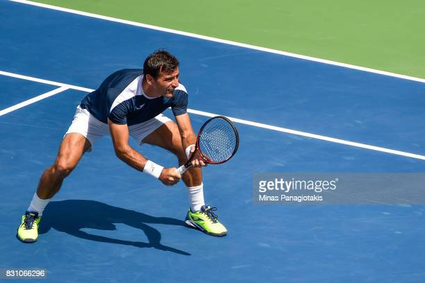 Ivan Dodig of Croatia gets into position during his doubles match against PierreHugues Herbert and Nicolas Mahut of France during day ten of the...