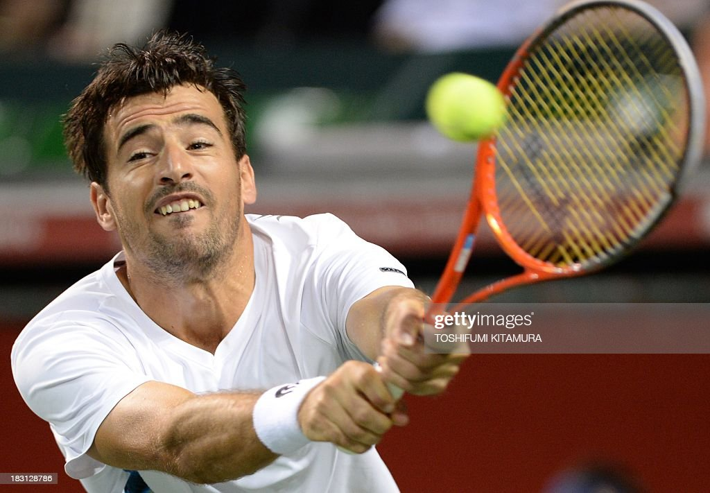 Ivan Dodig of Croatia hits a return against Milos Raonic of Canada during their men's singles semi-final match of the Japan Open tennis tournament in Tokyo on October 5, 2013.