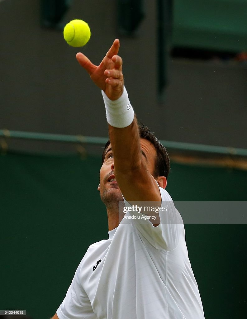 Ivan Dodig of Croatia in action against Tomas Berdych of Czech Republic in the men's Singles on day three of the 2016 Wimbledon Championships at the All England Lawn and Croquet Club in London, United Kingdom on June 29 2016.