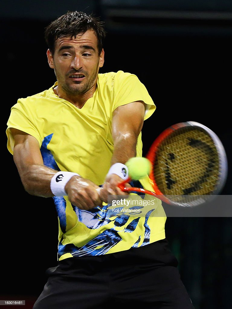 <a gi-track='captionPersonalityLinkClicked' href=/galleries/search?phrase=Ivan+Dodig&family=editorial&specificpeople=4888715 ng-click='$event.stopPropagation()'>Ivan Dodig</a> of Croatia in action during men's quarter final singles match against Jarkko Nieminen of Finland during day five of the Rakuten Open at Ariake Colosseum on October 4, 2013 in Tokyo, Japan.