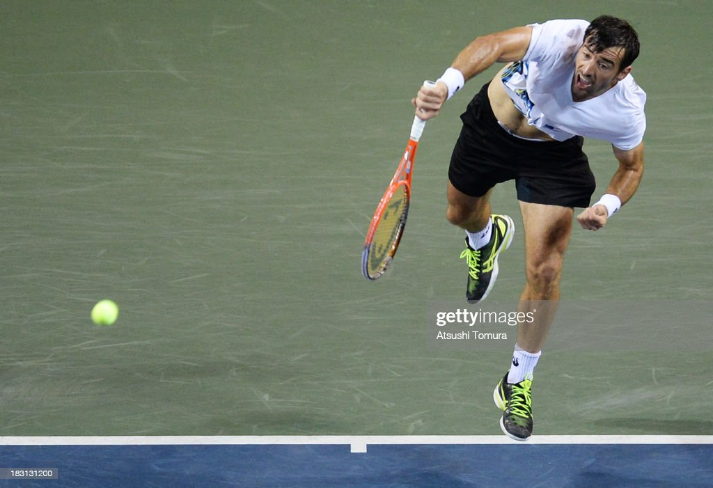 <a gi-track='captionPersonalityLinkClicked' href=/galleries/search?phrase=Ivan+Dodig&family=editorial&specificpeople=4888715 ng-click='$event.stopPropagation()'>Ivan Dodig</a> of Croatia in action during men's singles semi final match against Milos Raonic of Canada during day six of the Rakuten Open at Ariake Colosseum on October 5, 2013 in Tokyo, Japan.