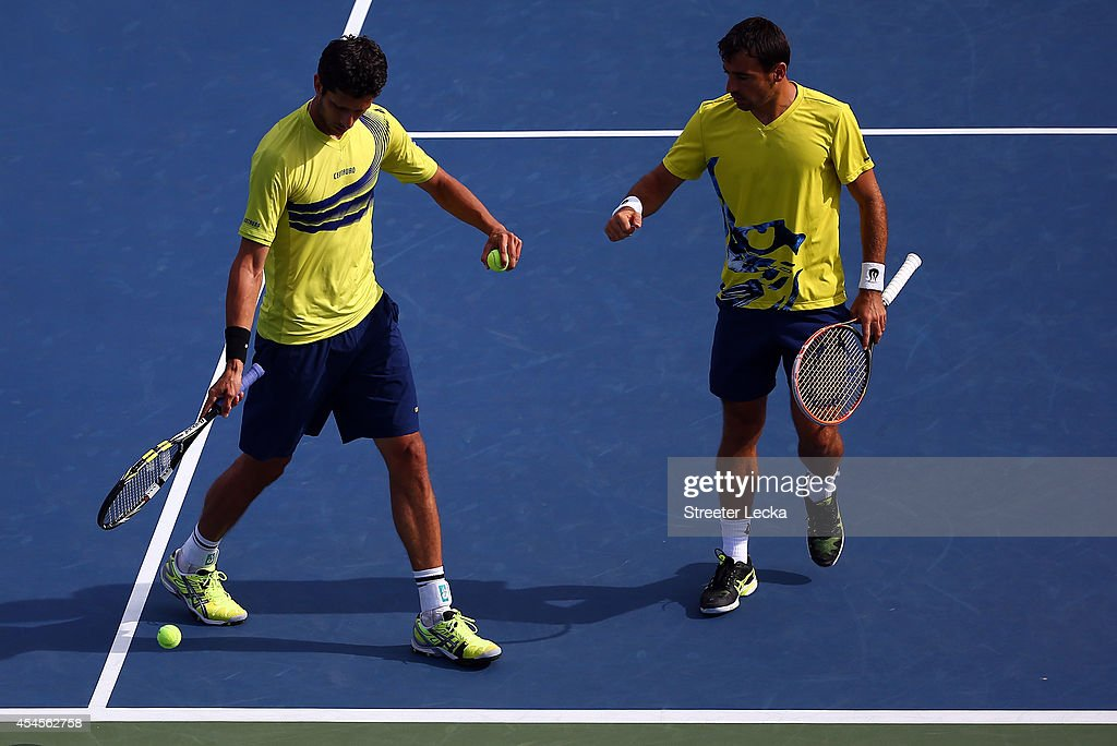 Ivan Dodig (R) of Croatia Marcelo Melo (L) of Brazil react against Carlos Berlocq and Leonardo Mayer of Argentina during their men's doubles quarterfinal match on Day Ten of the 2014 US Open at the USTA Billie Jean King National Tennis Center on September 3, 2014 in the Flushing neighborhood of the Queens borough of New York City.