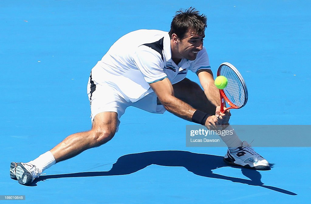 Ivan Dodig of Croatia plays a backhand during his match against Milos Raonic of Canada during day two of the AAMI Classic at Kooyong on January 10, 2013 in Melbourne, Australia.