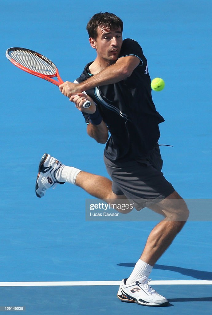 Ivan Dodig of Croatia plays a backhand during his match against Tomas Berdych of Czech Republic during day one of the AAMI Classic at Kooyong on January 9, 2013 in Melbourne, Australia.