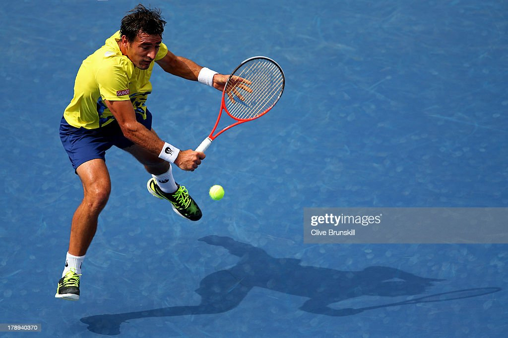 Ivan Dodig of Croatia plays a backhand volley during his men's singles third round match against Rafael Nadal of Spain on Day Six of the 2013 US Open at USTA Billie Jean King National Tennis Center on August 31, 2013 in the Flushing neighborhood of the Queens borough of New York City.