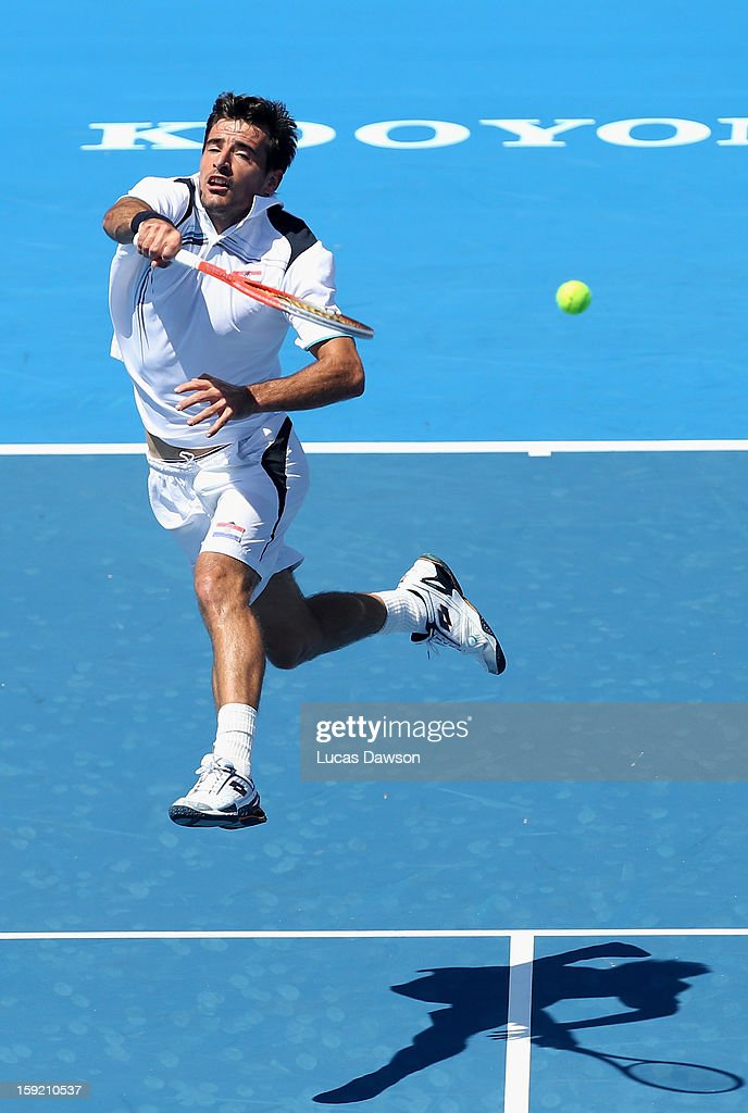 Ivan Dodig of Croatia plays a volley during his match against Milos Raonic of Canada during day two of the AAMI Classic at Kooyong on January 10, 2013 in Melbourne, Australia.