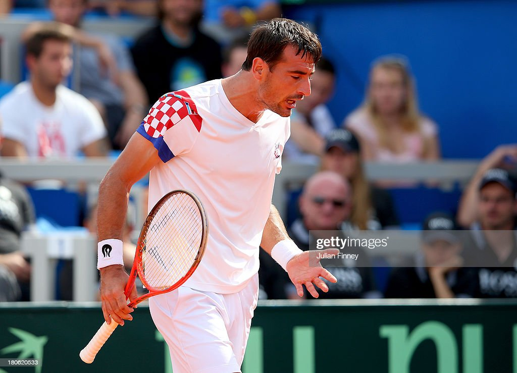 Ivan Dodig of Croatia reacts in his match against Andy Murray of Great Britain during day three of the Davis Cup World Group play-off tie between Croatia and Great Britain at Stadion Stella Maris on September 15, 2013 in Umag, Croatia.