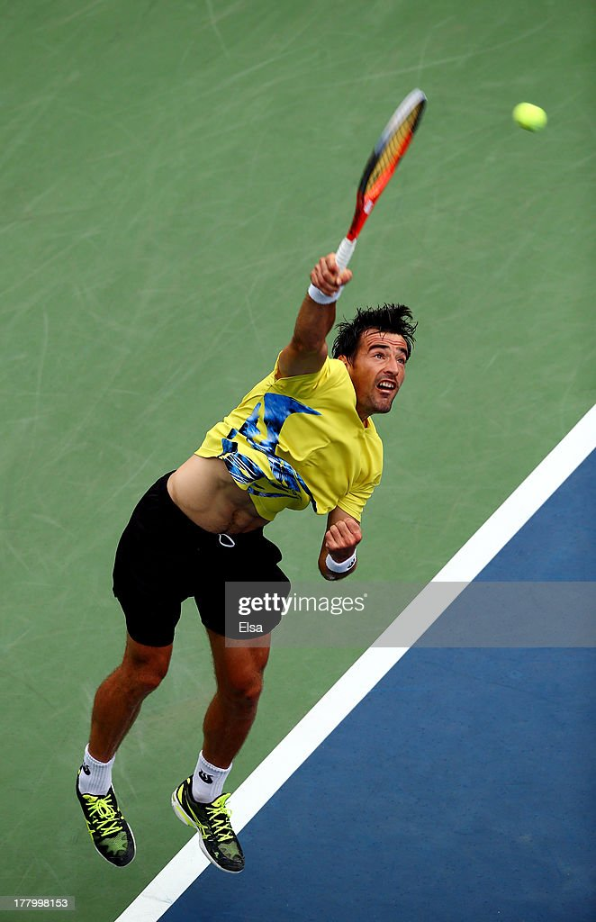 Ivan Dodig of Croatia serves to Fernando Verdasco of Spain during their men's singles first round match on Day One of the 2013 US Open at USTA Billie Jean King National Tennis Center on August 26, 2013 in the Flushing neighborhood of the Queens borough of New York City.