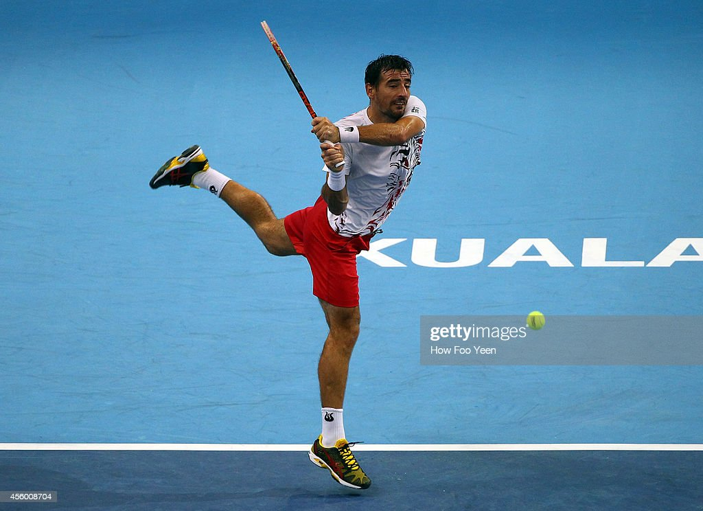 <a gi-track='captionPersonalityLinkClicked' href=/galleries/search?phrase=Ivan+Dodig&family=editorial&specificpeople=4888715 ng-click='$event.stopPropagation()'>Ivan Dodig</a> of Crotia plays a return shot to Pablo Cuevas of Uruguay during the Malaysian Open at Putra Stadium on September 24, 2014 in Kuala Lumpur, Malaysia.