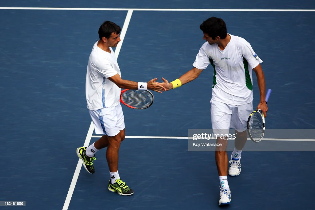 Ivan Dodig of Czech Republic and Marcelo Melo of Brazil celebrate a point during the men's first round doubles match against Kei Nishikori of Japan and Yasutaka Uchiyama during day one of the Rakuten Open at Ariake Colosseum on September 30, 2013 in Tokyo, Japan.