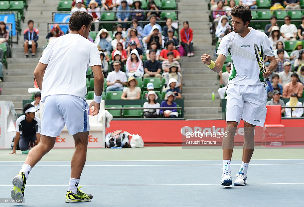 Ivan Dodig of Czech Republic and Marcelo Melo of Brazil react during the men's first round doubles match against Kei Nishikori of Japan and Yasutaka Uchiyama of Japan during day one of the Rakuten Open at Ariake Colosseum on September 30, 2013 in Tokyo, Japan.