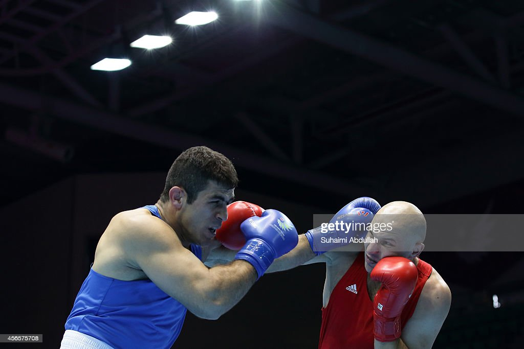 <a gi-track='captionPersonalityLinkClicked' href=/galleries/search?phrase=Ivan+Dychko&family=editorial&specificpeople=7359749 ng-click='$event.stopPropagation()'>Ivan Dychko</a> of Kazakhstan (red) fights Jasem Delavari of Iran (blue) during the Men's Super Heavyweight Final on day fourteen of the 2014 Asian Games match at Seonhak Gymnasium on October 3, 2014 in Incheon, South Korea.