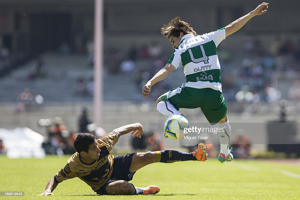 Ivan Estrada (R) of Santos struggles for the ball with Luis Fuentes (L) of Pumas during a match between Pumas and Santos as part of the Clausura 2013 at Olímpico Stadium on February 03, 2013 in Mexico City, Mexico.