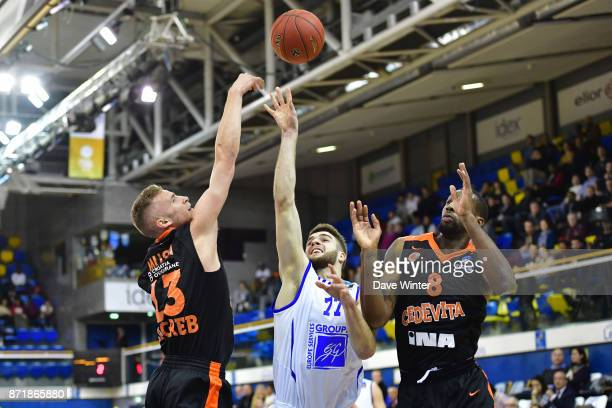 Ivan Fevrier of Levallois shoots between Dzanan Musa of Cedevita Zagreb and Demetris Nichols of Cedevita Zagreb during the EuropCup match between...
