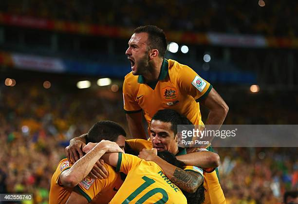 Ivan Franjic of Australia celebrates after Massimo Luongo of Australia scored his teams first goal during the 2015 Asian Cup final match between...