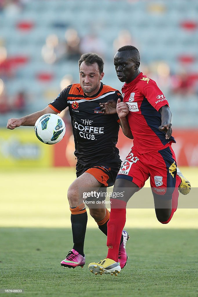 Ivan Franjic of Brisbane competes with Awer Mabil of Adelaide competes for the ball during the round 23 A-League match between Adelaide United and the Brisbane Roar at Hindmarsh Stadium on March 2, 2013 in Adelaide, Australia.