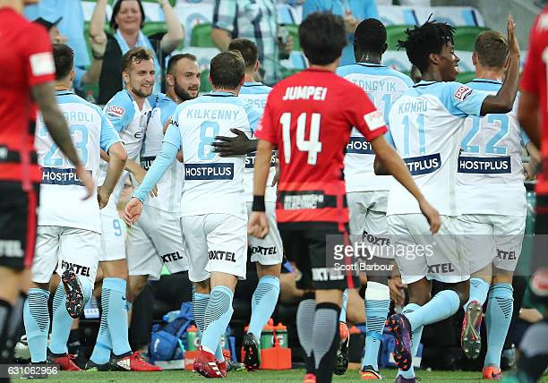 Ivan Franjic of City FC celebrates with his teammates after scoring the first goal during the round 14 ALeague match between Melbourne City FC and...