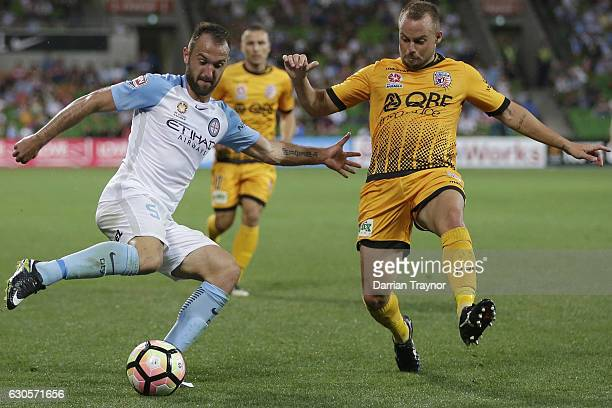 Ivan Franjic of Melbourne City kicks the ball as Marc Warren of Perth Glory attempts to defend during the round 12 ALeague match between Melbourne...