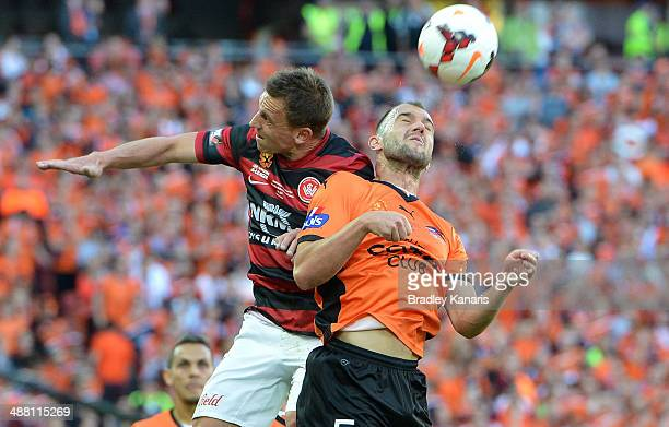 Ivan Franjic of the Roar and Brendon Santalab of the Wanderers compete for the ball during the 2014 ALeague Grand Final match between the Brisbane...