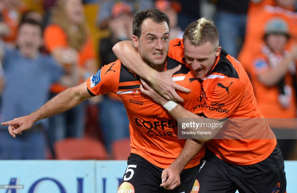 Ivan Franjic (L) of the Roar celebrates with team mate Besart Berisha after scoring a goal during the round 24 A-League match between the Brisbane Roar and the Melbourne Victory at Suncorp Stadium on March 9, 2013 in Brisbane, Australia.