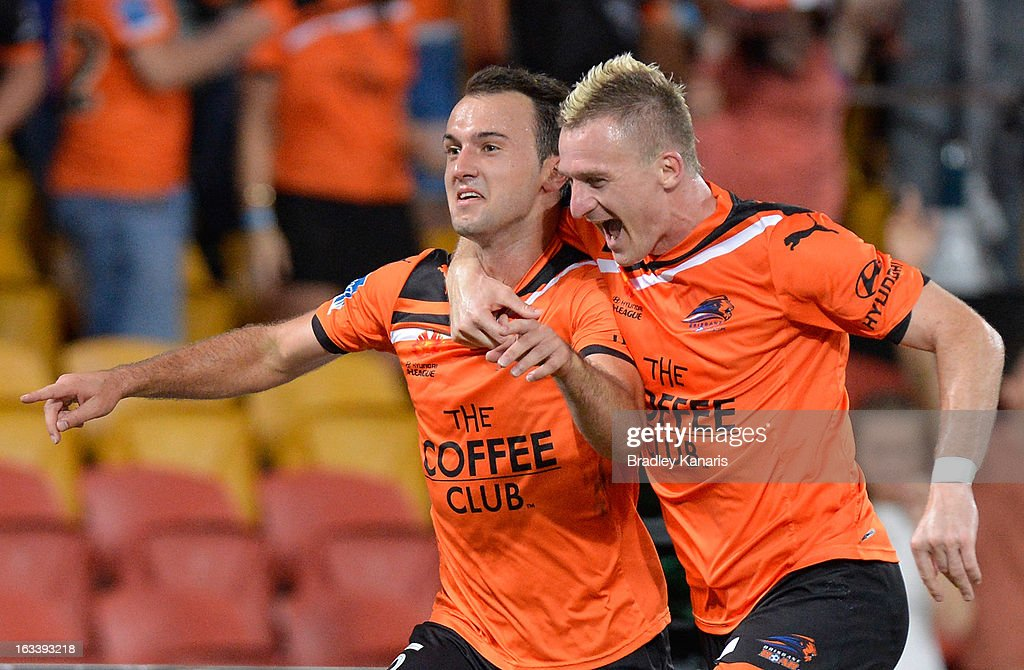 Ivan Franjic of the Roar celebrates with team mate Besart Berisha after scoring a goal during the round 24 A-League match between the Brisbane Roar and the Melbourne Victory at Suncorp Stadium on March 9, 2013 in Brisbane, Australia.