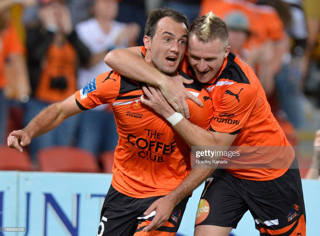 Ivan Franjic of the Roar celebrates with team mate <a gi-track='captionPersonalityLinkClicked' href=/galleries/search?phrase=Besart+Berisha&family=editorial&specificpeople=737057 ng-click='$event.stopPropagation()'>Besart Berisha</a> after scoring a goal during the round 24 A-League match between the Brisbane Roar and the Melbourne Victory at Suncorp Stadium on March 9, 2013 in Brisbane, Australia.