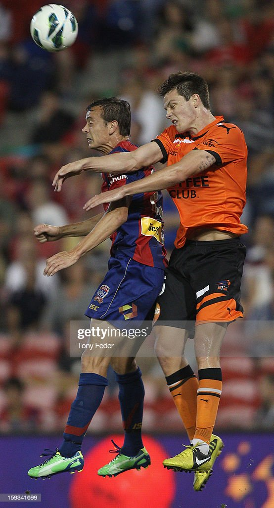 Ivan Franjic (R) of the Roar contests the ball with Ryan Griffiths of the Jets during the round 16 A-League match between the Newcastle Jets and the Brisbane Roar at Hunter Stadium on January 12, 2013 in Newcastle, Australia.