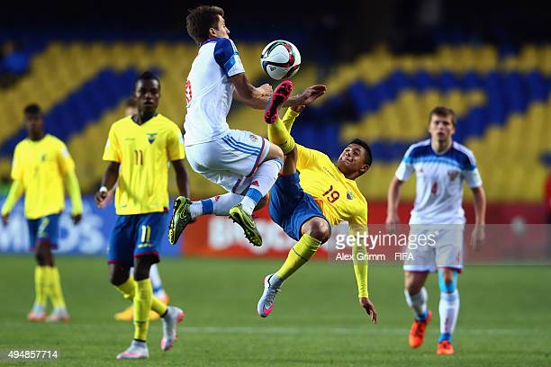 Ivan Galanin of Russia is challenged by Anderson Naula of Ecuador during the FIFA U17 World Cup Chile 2015 Round of 16 match between Russia and...