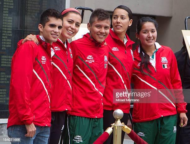Ivan García Aida Román Germán Sánchez Laura Sánchez y Mariana Avitia pose during an exibition as part of the olympic day celebration at Mexican...