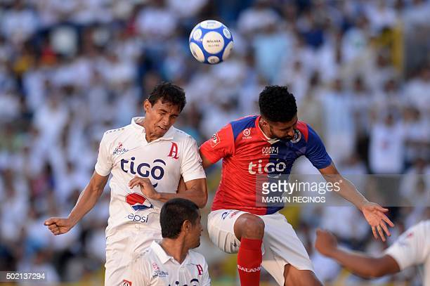 Ivan Garrido of Alianza vies for the ball with Josimar Moreira of FAS during their 2015 El Salvador Apertura tournament final football match in San...