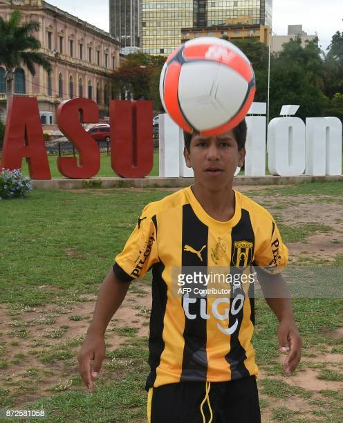 Ivan Genes performs pirouettes with a football on a square in Asuncion on November 10 2017 Two days after a local media pubished Ivan's performance...