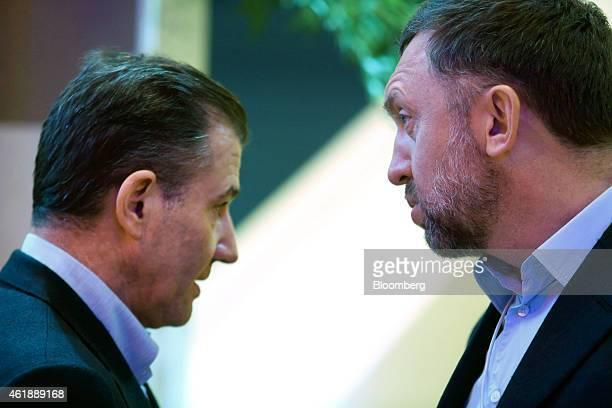 Ivan Glasenberg billionaire and chief executive officer of Glencore Xstrata Plc left speaks with Oleg Deripaska billionaire and chief executive...