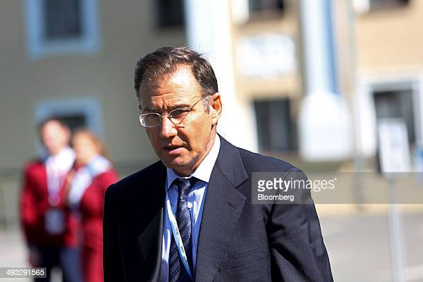 Ivan Glasenberg billionaire and chief executive officer of Glencore Xstrata Plc walks between sessions at the St Petersburg International Economic...