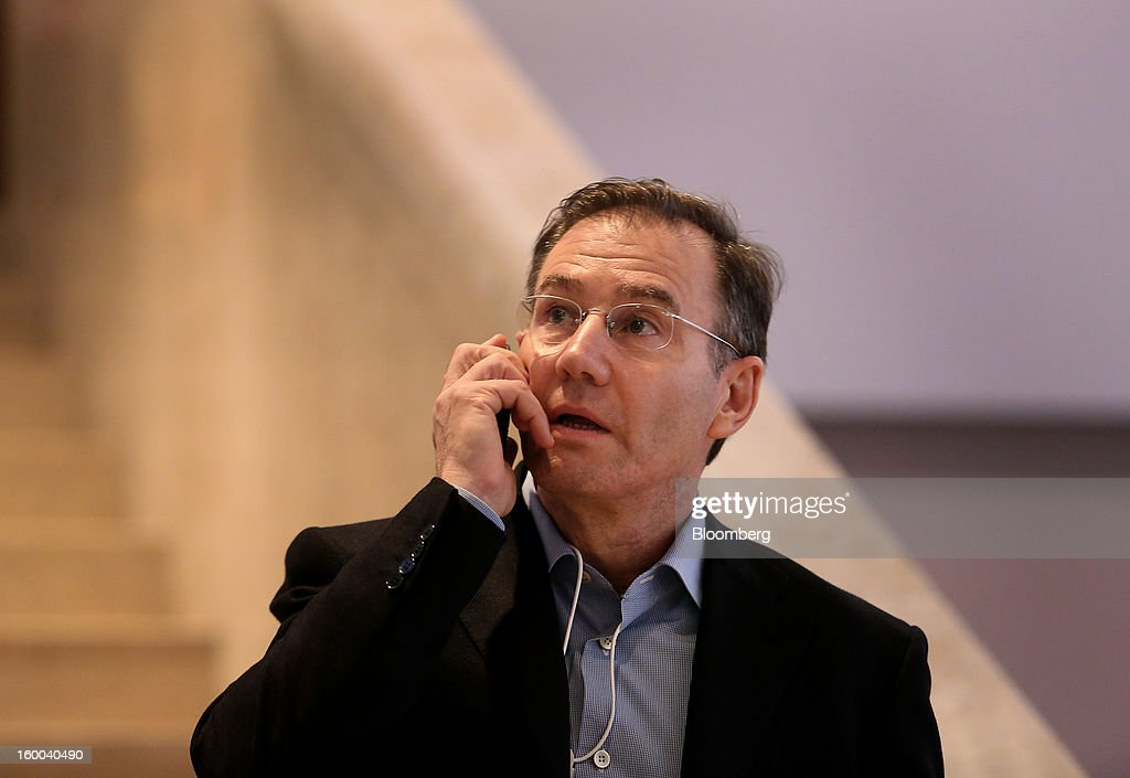 Ivan Glasenberg, chief executive officer of Glencore International Plc, speaks on his mobile phone inside the Congress Center on day three of the World Economic Forum (WEF) in Davos, Switzerland, on Friday, Jan. 25, 2013. World leaders, influential executives, bankers and policy makers attend the 43rd annual meeting of the World Economic Forum in Davos, the five day event runs from Jan. 23-27. Photographer: Chris Ratcliffe/Bloomberg via Getty Images
